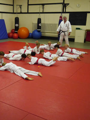 Kids warming up before the Judo class grading starts.