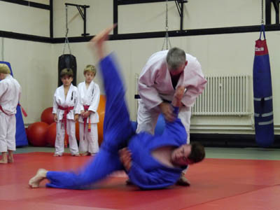 Sensei Dave Clarke demonstrates a throw before the Judo students demonstrate their skills.
