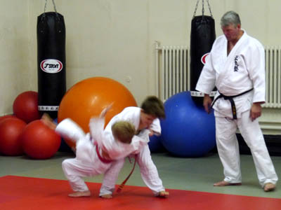 Two children show of their Judo skills during the grading.